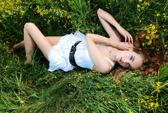 Woman liying on the meadow. Portrait of the young beautiful woman liying on the meadow Royalty Free Stock Image
