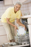 Woman Loading Dishwasher Royalty Free Stock Photo