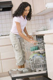 Woman Loading Dishwasher Royalty Free Stock Photography