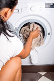 Woman loading laundry Royalty Free Stock Photos