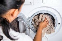 Woman loading laundry Stock Photos