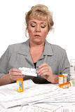 Woman loading pill dispenser Stock Photography