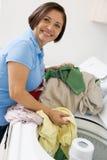 Woman Loading Washing Machine Stock Photography