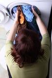 Woman loading the washing machine in bathroom. Woman loading Preparation washing machine in bathroom clothes in the washing machine Stock Images