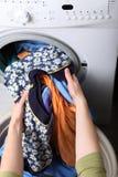 Woman loading the washing machine in bathroom. Woman loading Preparation washing machine in bathroom clothes in the washing machine Royalty Free Stock Image