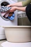 Woman loading the washing machine in bathroom. Woman loading Preparation washing machine in bathroom clothes in the washing machine Stock Photos
