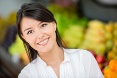 Woman at the local market Royalty Free Stock Image