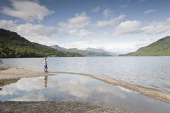 Woman at Loch Lomond Stock Image