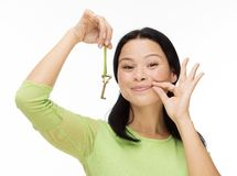 Woman locked mouth with key on white Royalty Free Stock Image