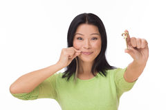 Woman locked mouth with key on white Royalty Free Stock Photo