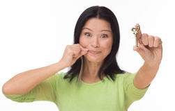 Woman locked mouth with key on white Royalty Free Stock Photography