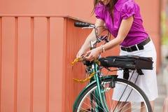 Woman locking padlock Royalty Free Stock Images