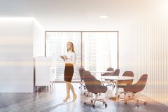 Woman in loft office waiting room interior royalty free stock image