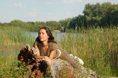 Woman on log Stock Image