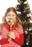 Woman with lolipop and tree Stock Image