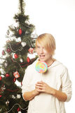 Woman with lolipop and tree. Happy woman with lolipop and tree Royalty Free Stock Photography