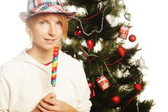 Woman with lolipop and tree. Happy woman with lolipop and tree Stock Photography