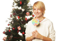 Woman with lolipop and tree. Isolated on white Stock Photos