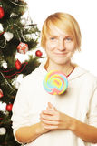 Woman with lolipop and tree. Isolated on white Stock Photo