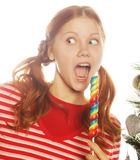 Woman with lolipop and tree Royalty Free Stock Photos