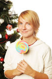 Woman with lolipop and tree. Young woman with lolipop and tree Stock Image