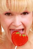 Woman with lollipop Stock Images