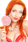 Woman with lollipop. Portrait of redhead woman with big lollipop Royalty Free Stock Photography