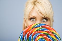 Woman with a lollipop Stock Photo