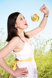 Woman and lollipop Stock Photo