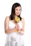 Woman and lollipop Stock Photos