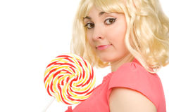 Woman with lollipop (focus on face) Stock Photos