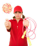 Woman with lollipop and jump rope Stock Photo