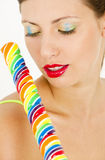 Woman with a lollypop. Portrait of woman with a lollypop Stock Photography