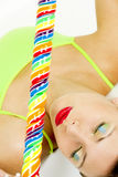 Woman with a lollypop. Portrait of lying woman with a lollypop Royalty Free Stock Photography
