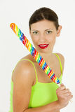 Woman with a lollypop. Portrait of woman with a lollypop Stock Photo