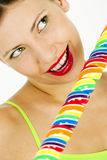 Woman with a lollypop. Portrait of woman with a lollypop Royalty Free Stock Image
