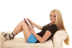 Woman long blond hair blue shorts hold tablet smile Royalty Free Stock Photography