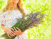 Woman with long blond hair with lavender bouquet Royalty Free Stock Photos