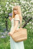 Woman With Basket In Spring Blossom Stock Images