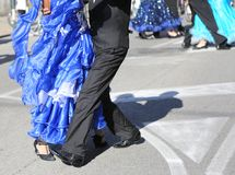 Woman with long blue dress dancing with a man outdoor Stock Photography