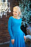 Woman in long blue dress. Luxury interior Stock Images