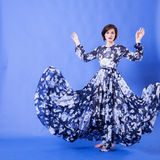 Woman with long blue flying dress in studio photo. Elegance and beauty Stock Photos