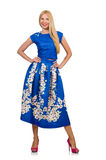 The woman in long blue folral dress isolated on white Stock Photo