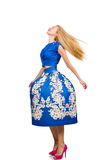 Woman in long blue folral dress  on white Stock Image