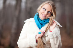 Woman with a long braid Royalty Free Stock Photography