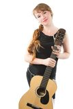 Woman with long braid and guitar Stock Image