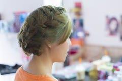 Woman long braid hair creative styling bride hairstyle Stock Photo