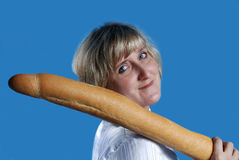 Woman with long bread roll. Woman holding long bread roll on blue background Royalty Free Stock Photo