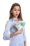 Woman with long brown hair earns money. On an isolated white background for cut out Stock Images