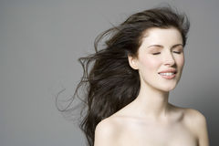 Woman With Long Brown Hair And Eyes Closed royalty free stock photography